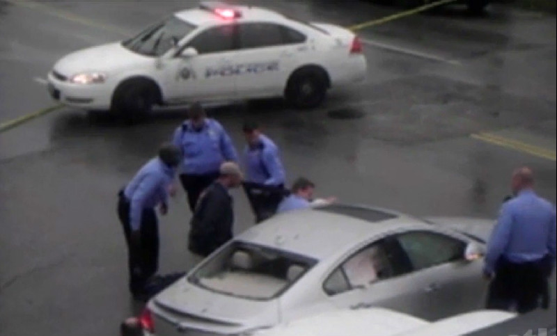St. Louis Police Officer Caught On Video Planting Gun On Black Man After Killing Him