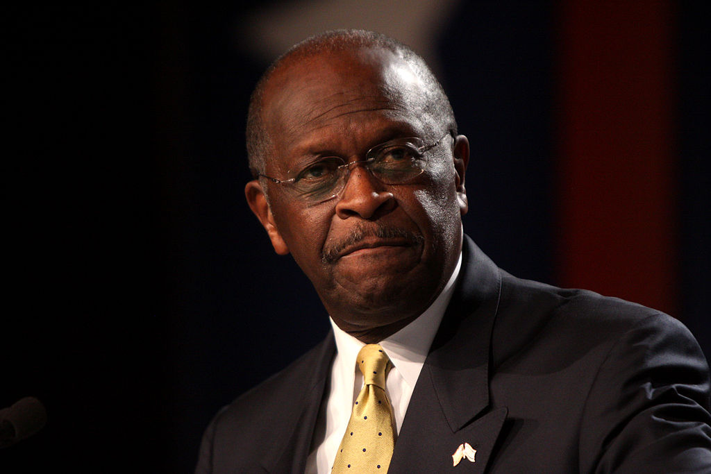 Herman Cain Attended Trump's Tulsa Rally. Now He's Hospitalized with Covid-19.