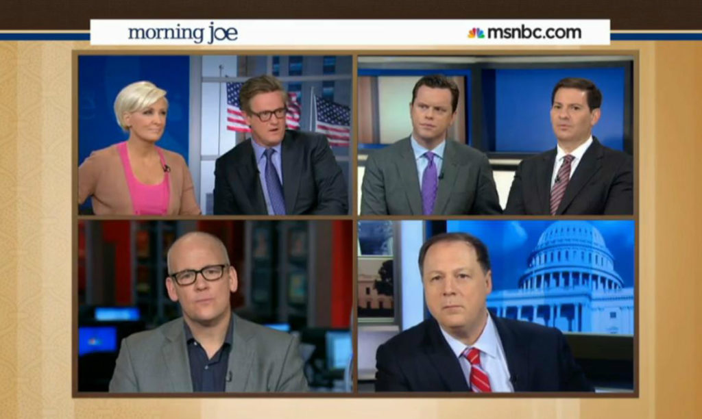 """""""We've discussed it amongst ourselves and decided that racism is over."""" (Photo: Screen grab from 'Morning Joe' where they actually did this.)"""